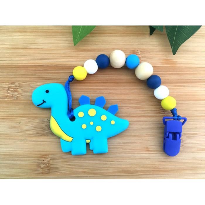 Jouets de Dentition / attache suce dinosaure bleu